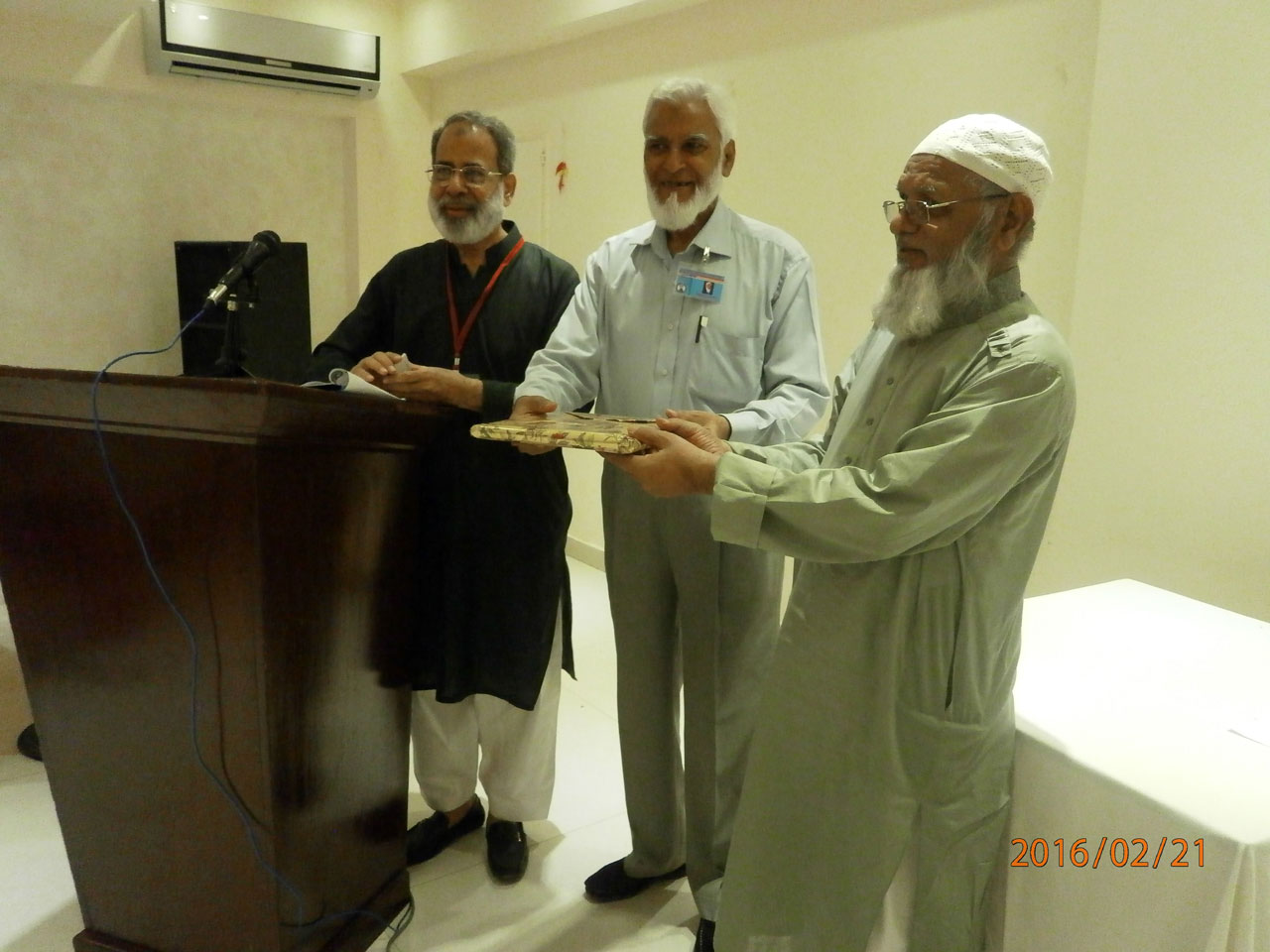 Kamal A. Farooqi is presenting a gift to Ataullah on his Happy Birthday
