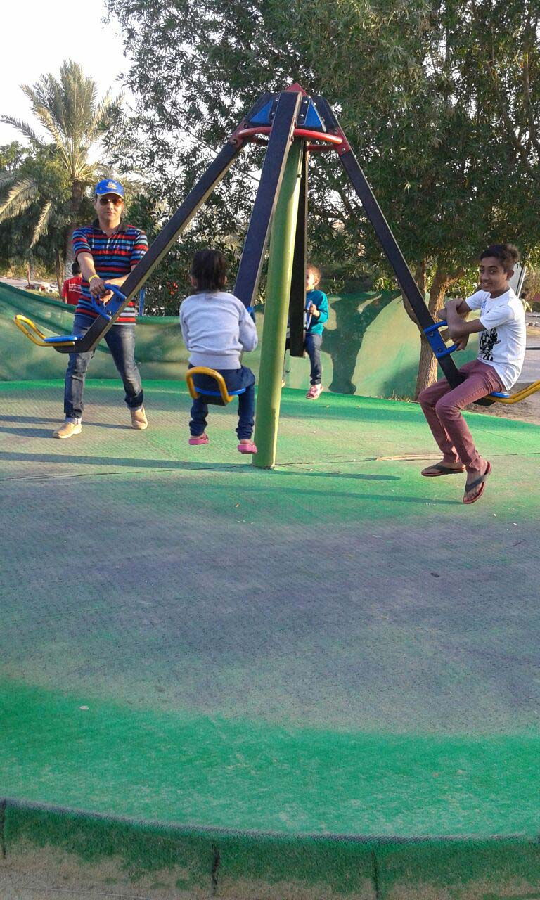 Imran and kids are having fun on the swing