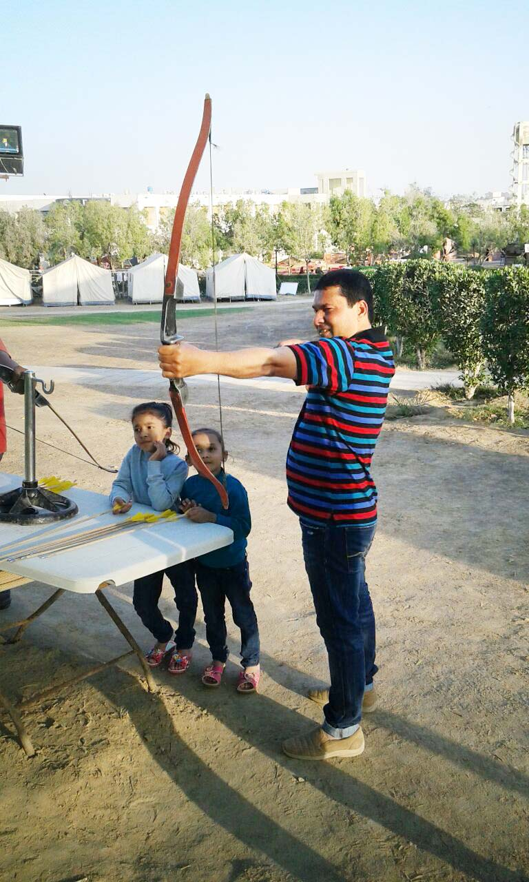Imran A. Khan is trying the bow and arrow game
