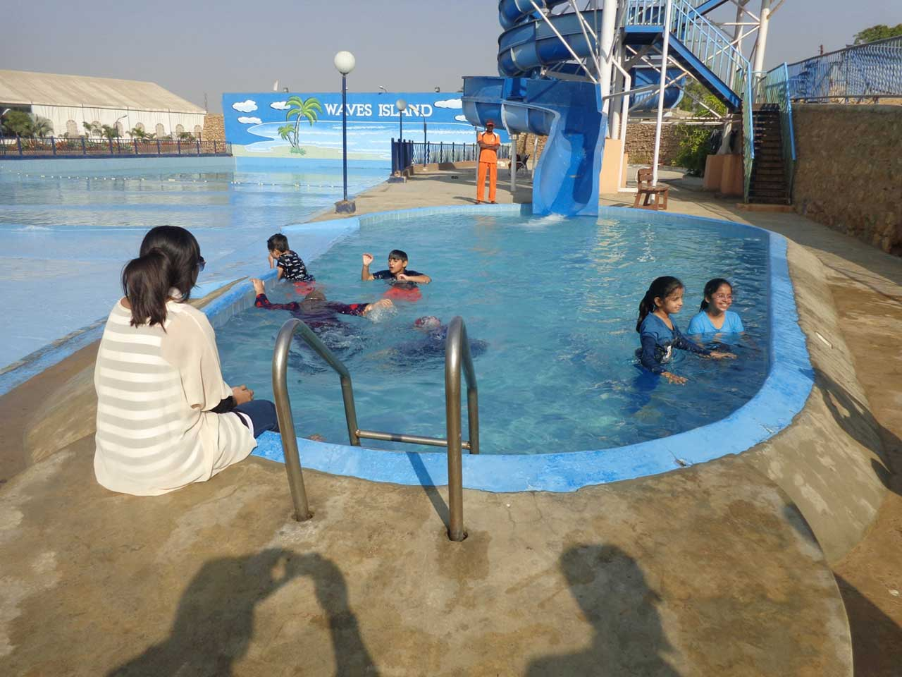 Kids are enjoying in the pool