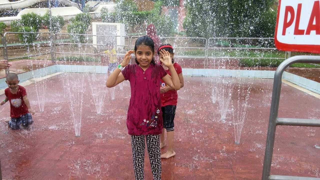 Zara Imran having fun under the artificial raining