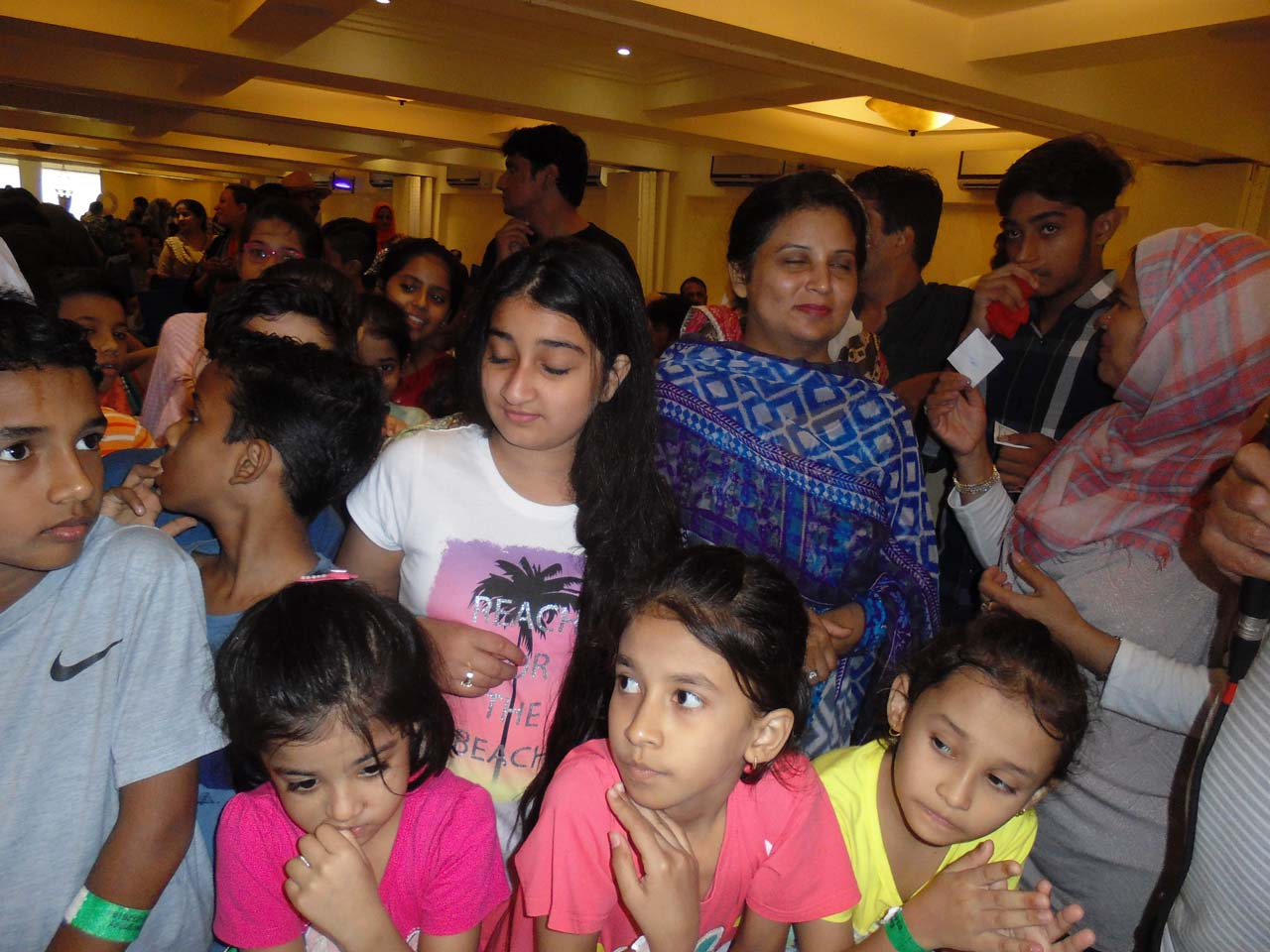 All the kids are waiting to receive their gifts from Kamal A. Farooqi
