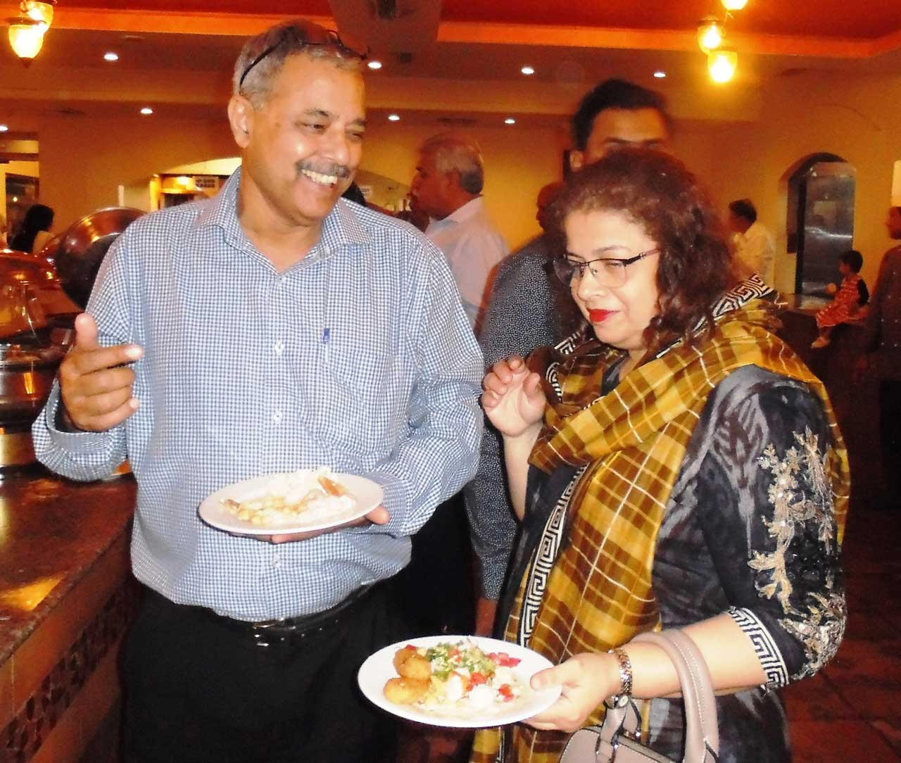 Arif Qamar and his wife are enjoying the food