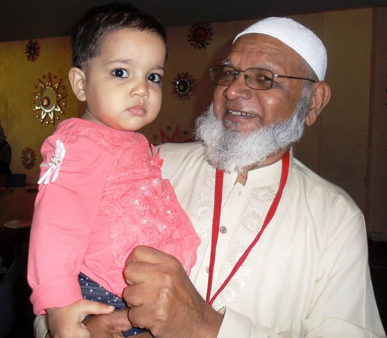 Atauddin Qureshi with his grand daughter