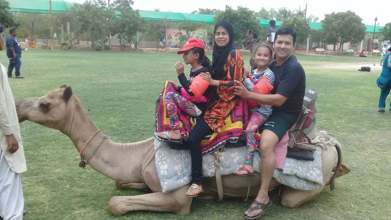 Imran, Tania family are enjoying the camel ride at the farm house
