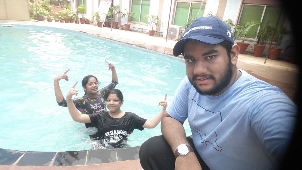 Engr. Taha A. Khan, Zoya Imran and Mariam A. Rehman are enjoying at the swimming pool