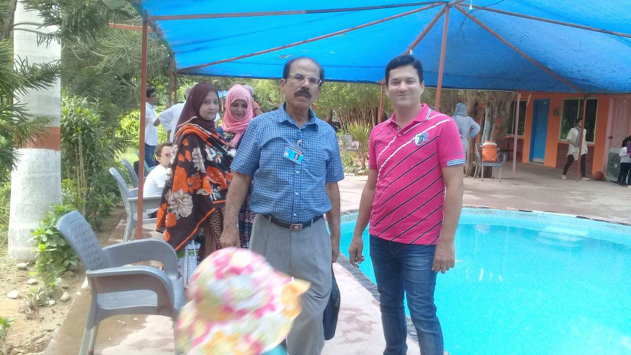 Mrs. Shafiq A. Khan, Tania Imran, Shafiq A. Khan and Imran A. Khan at the swimming pool