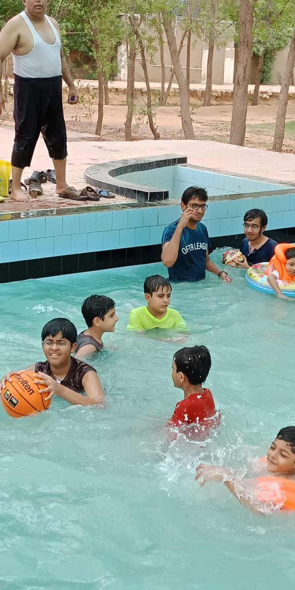 Dr. Ata Ur Rehman, Dr. Faraz Salim, Habib Ur Rehman are playing inside the swimming pool