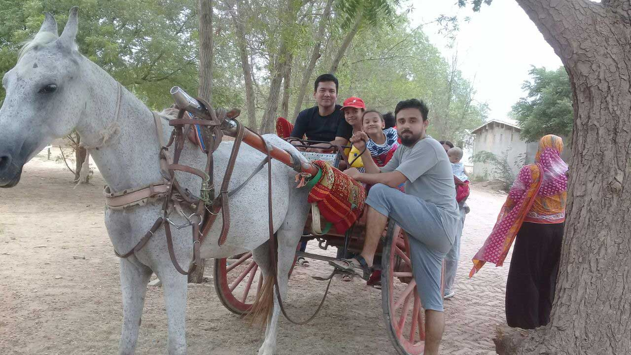 "Imran Khan and Shabeel Khan along with kids are enjoying the ""Tanga"" ride at the farm house"