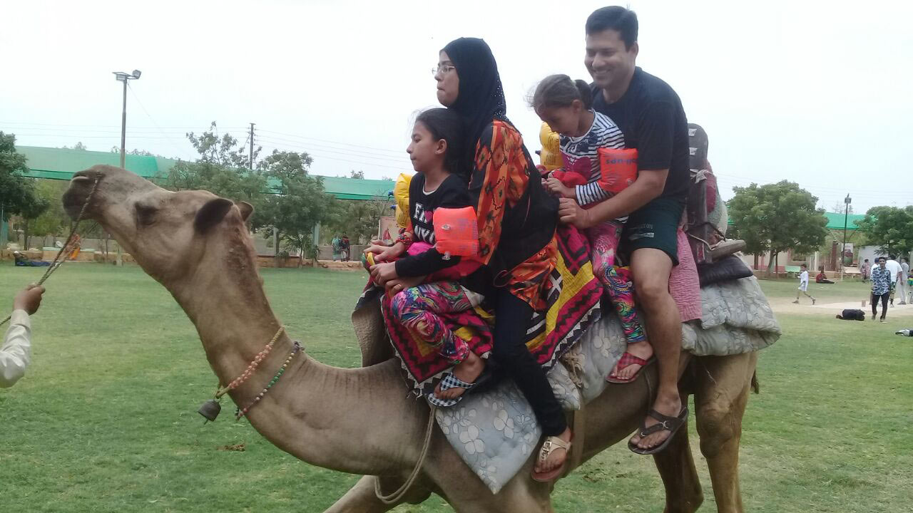 Tania Imran is scared while the camel is about to sit at the farm house