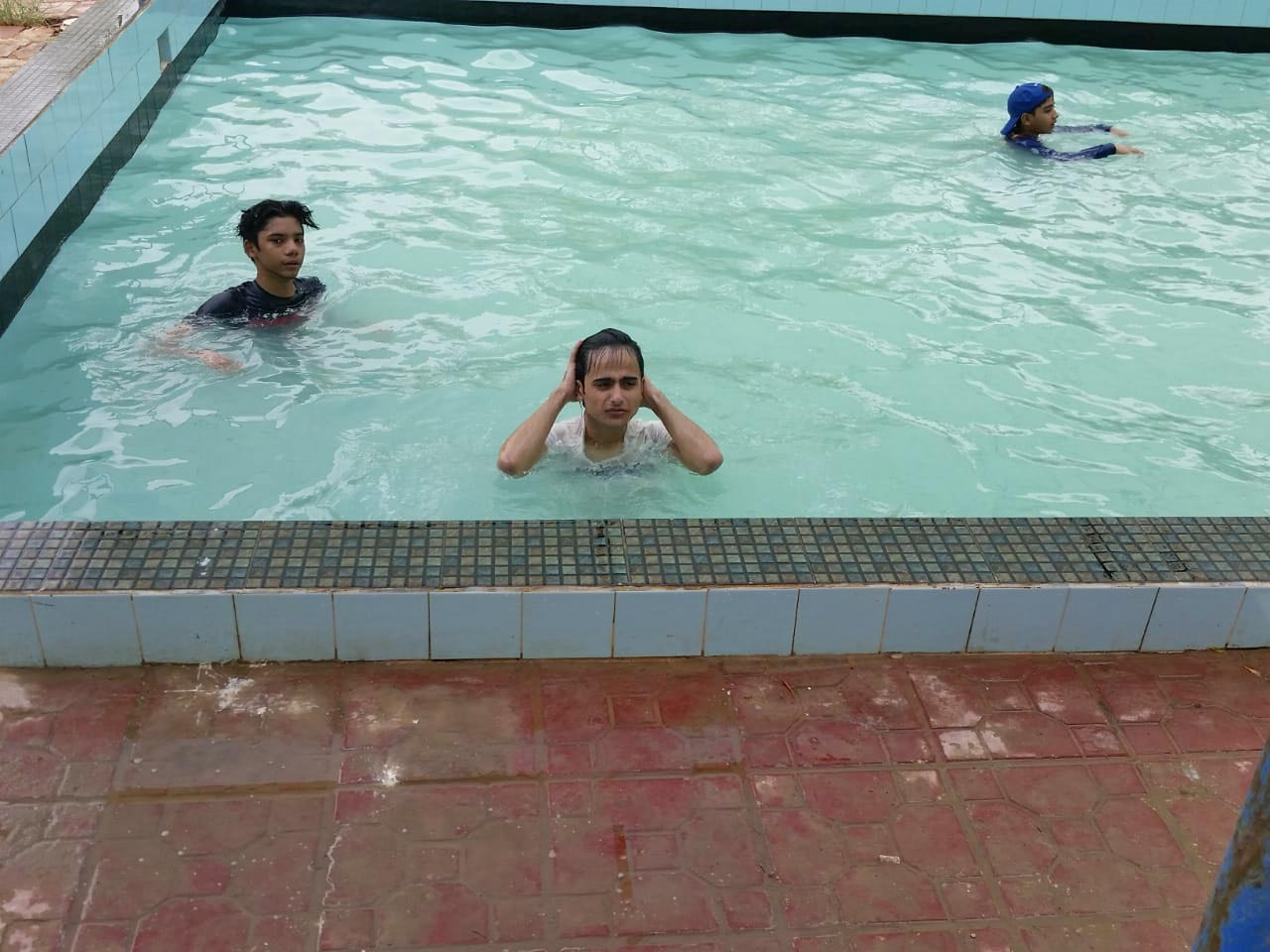 The kids are enjoying inside the swimming pool