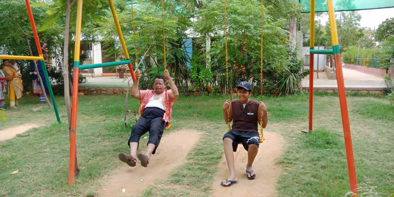 Dr. Ata Ur Rehman and Habib Ur Rehman are enjoying the swings at the farm house