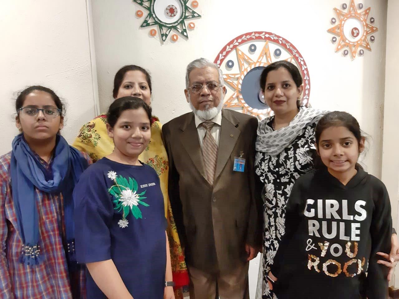 Engr. Iqbal A. Khan with his daughters and the grand kids