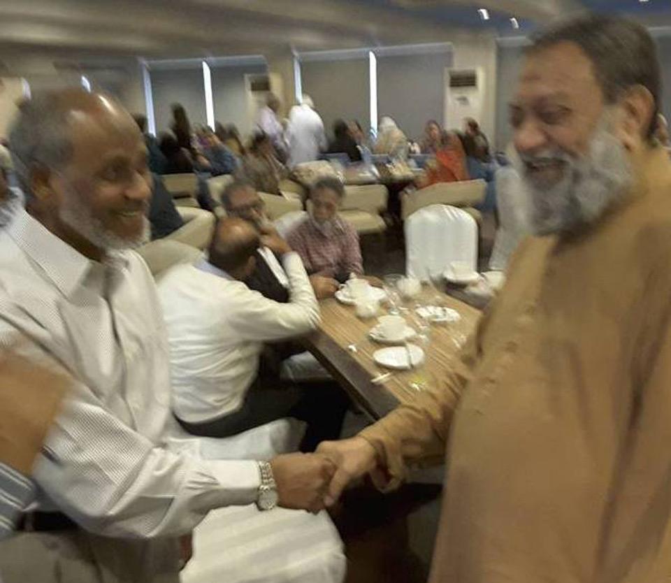 Saif Ur Rehman greeting Dr. Salim Siddiqui