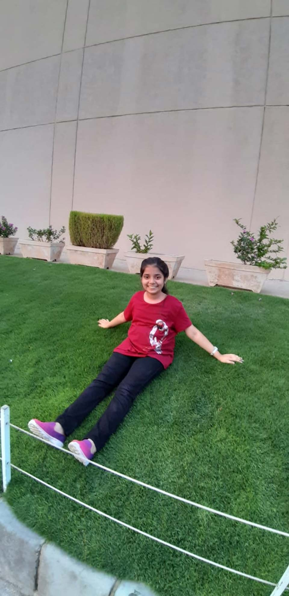 Zara Imran is enjoying the nice grass outside the Arena Club