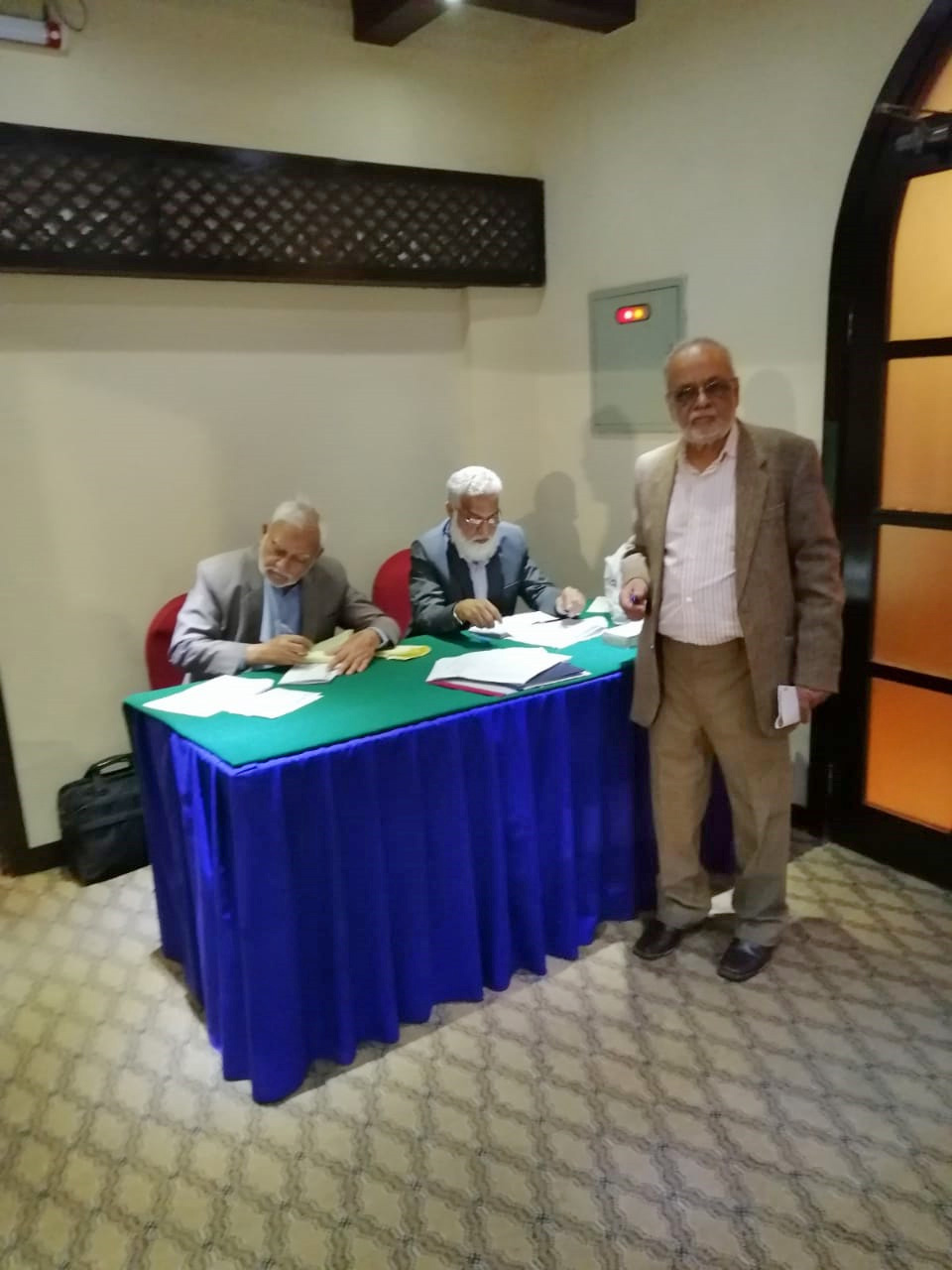 Syed Shabbar Abidi, Jamiluddin Shaikh and Mohammad Abdul Matin at the entrance counter