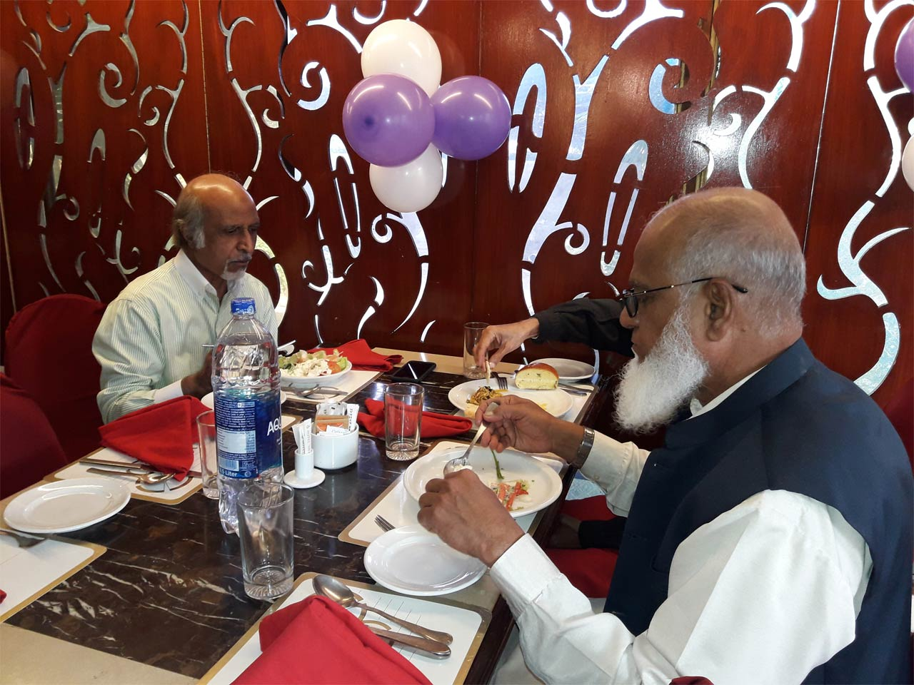 Mujeeb Ur Rehman and Mohammad Sirajuddin enjoying their brunch ay the dinning hall