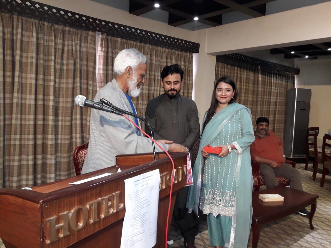 Kamal A. Farooqi is presenting a gift on behalf of SAEEA to Shabeel and Sahrish the newly wed couple