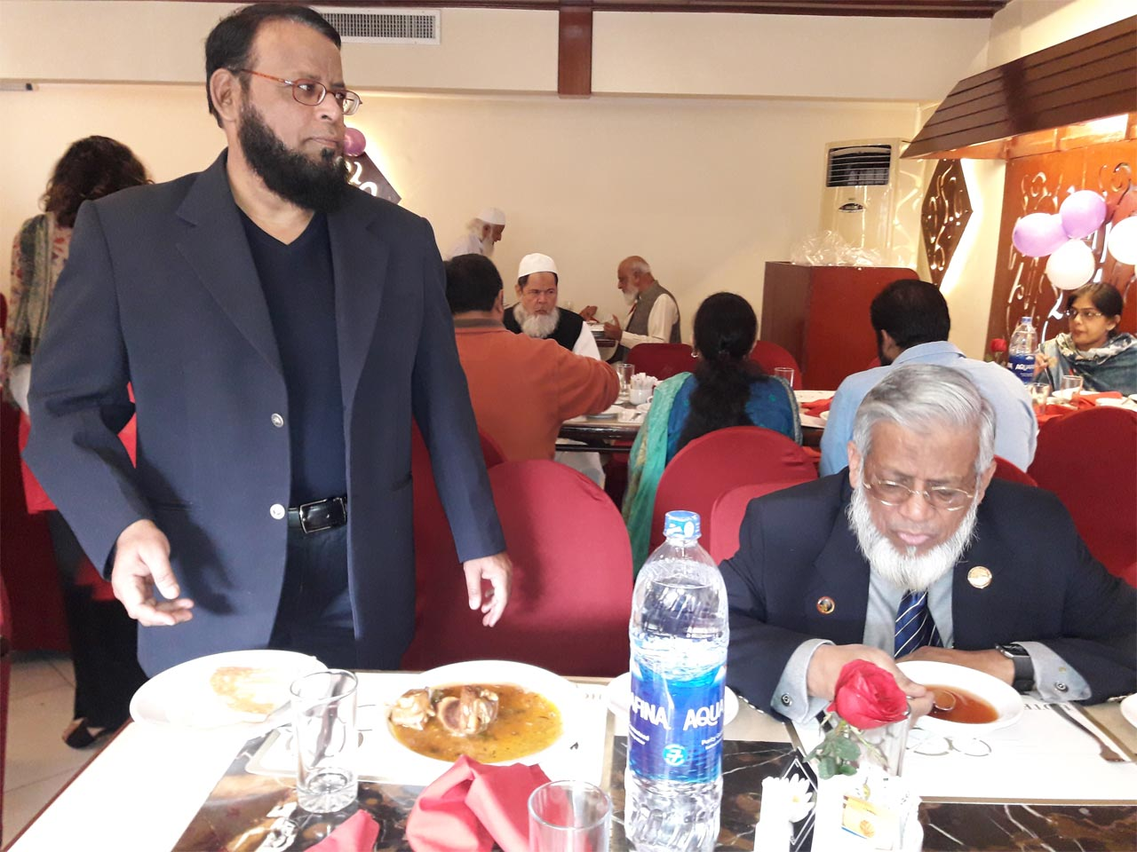 Dr. Ata Ur Rehman, Engr. Iqbal Ahmed Khan is enjoying his brunch