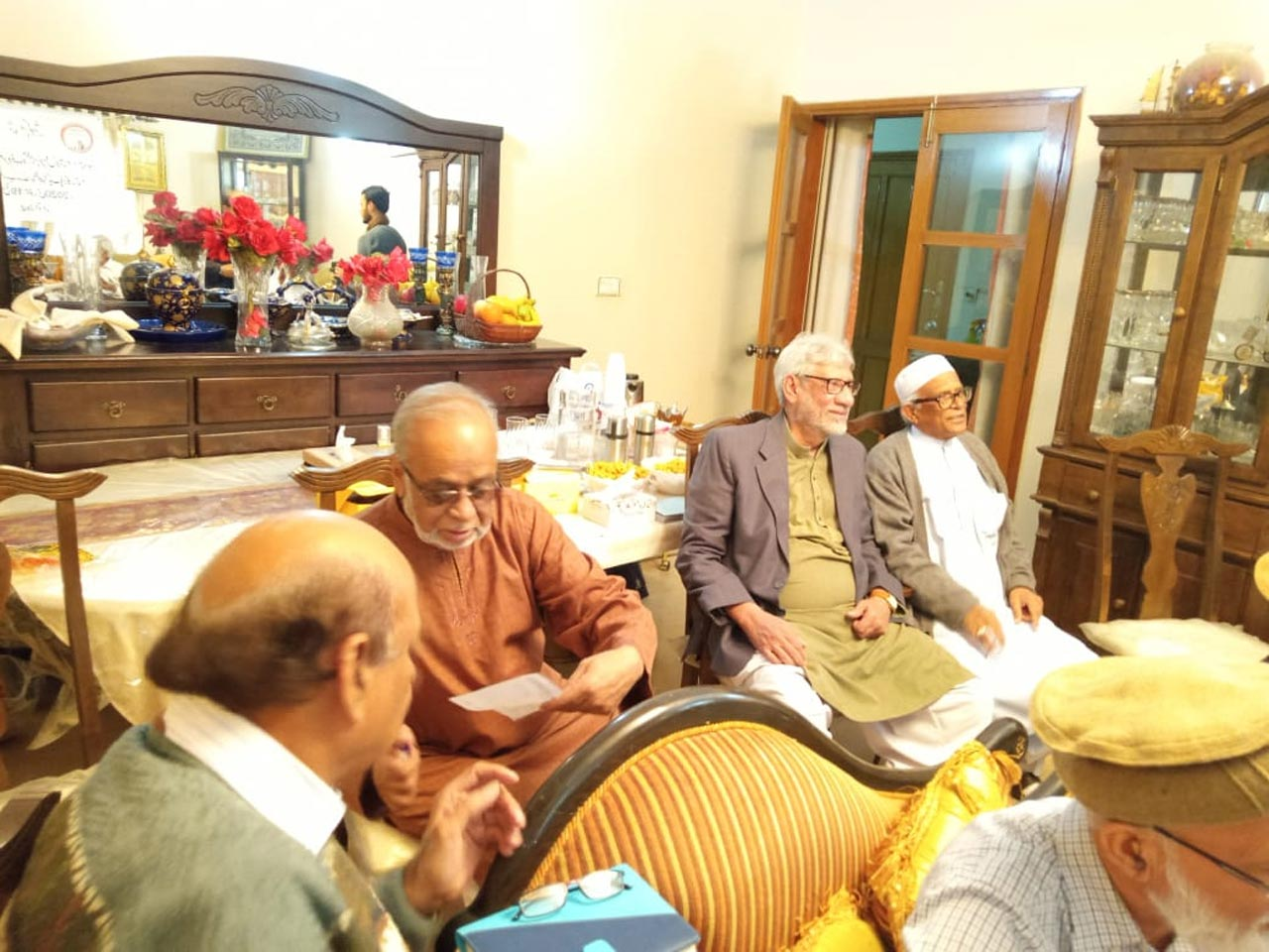 Mohammad Abdul Matin is discussing some important issue with Farooq Khan
