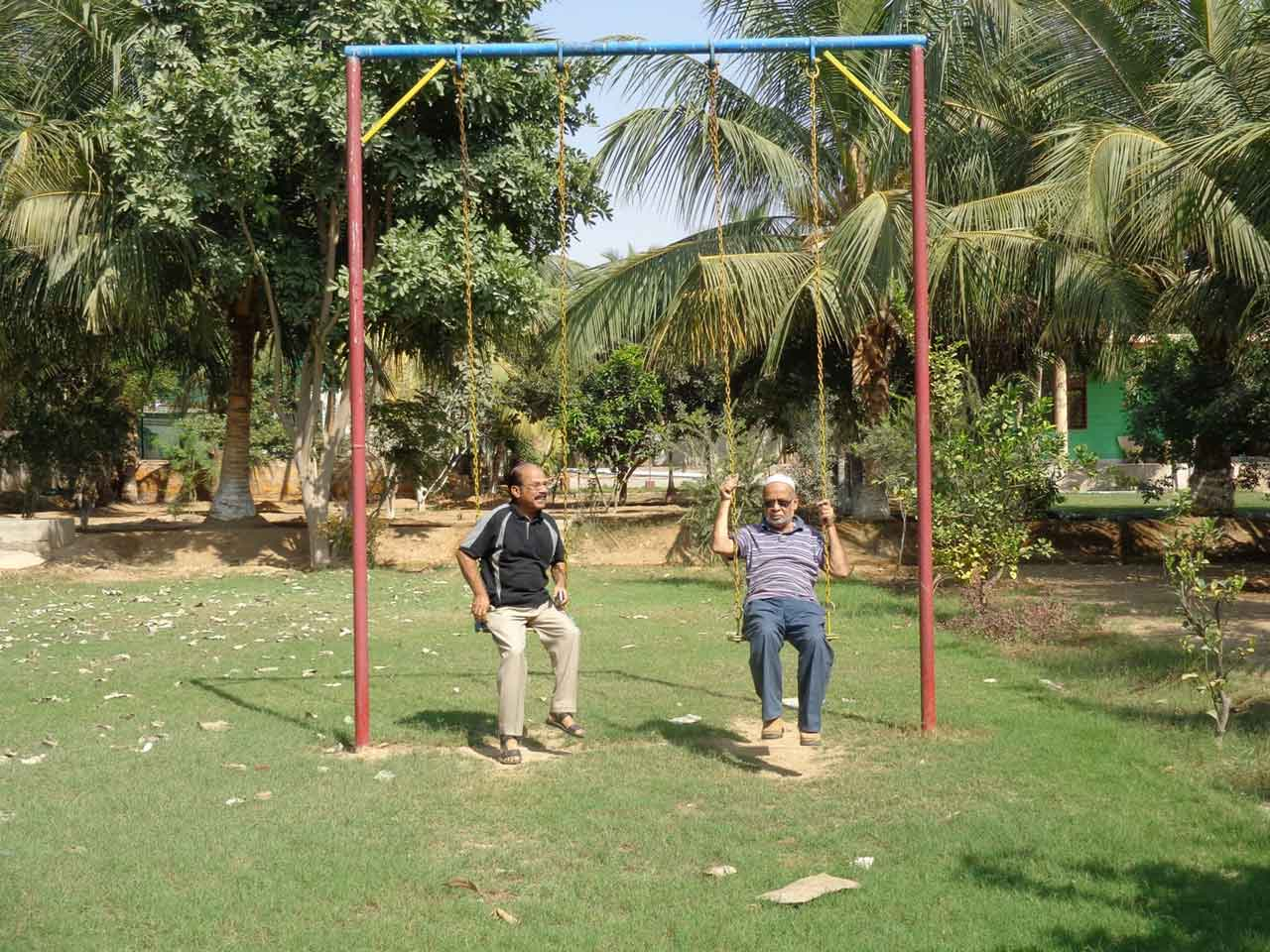 Shafiq A. Khan and Mohammad A. Mateen enjoying on the swing