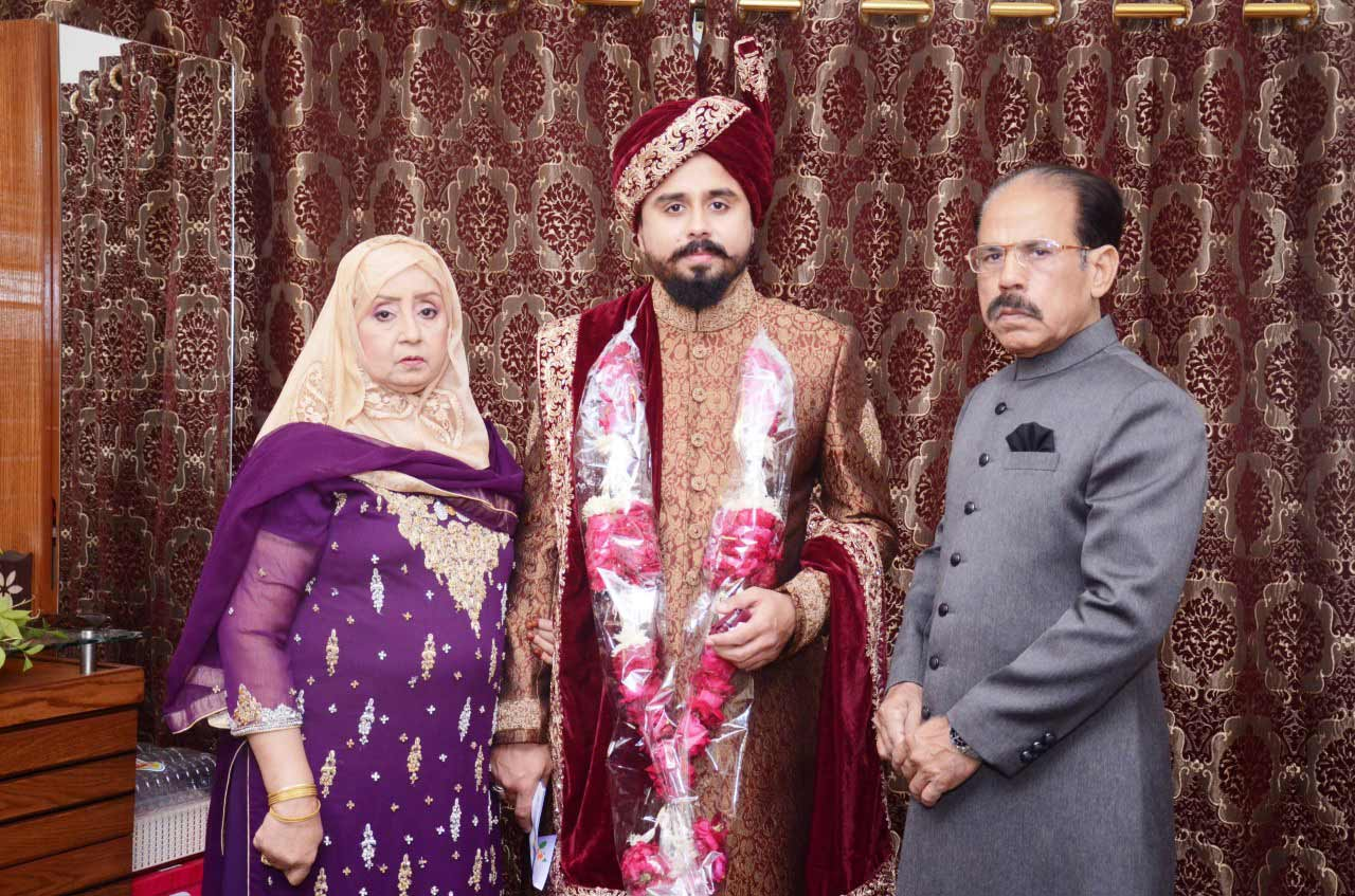 Shabeel with his parents at the Nikah reception