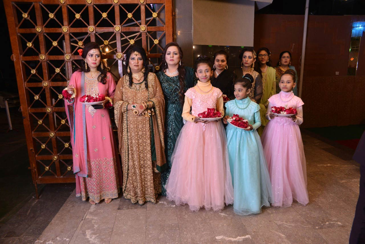 The sisters and nieces of the bride groom waiting for the arrival of bride family
