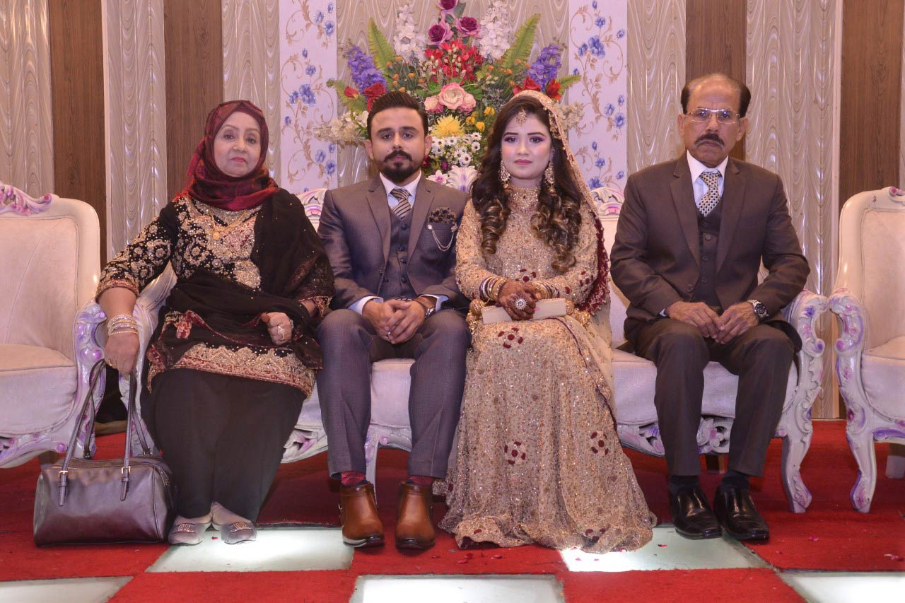 The newlywed couple with the parents of the groom at the Valima reception