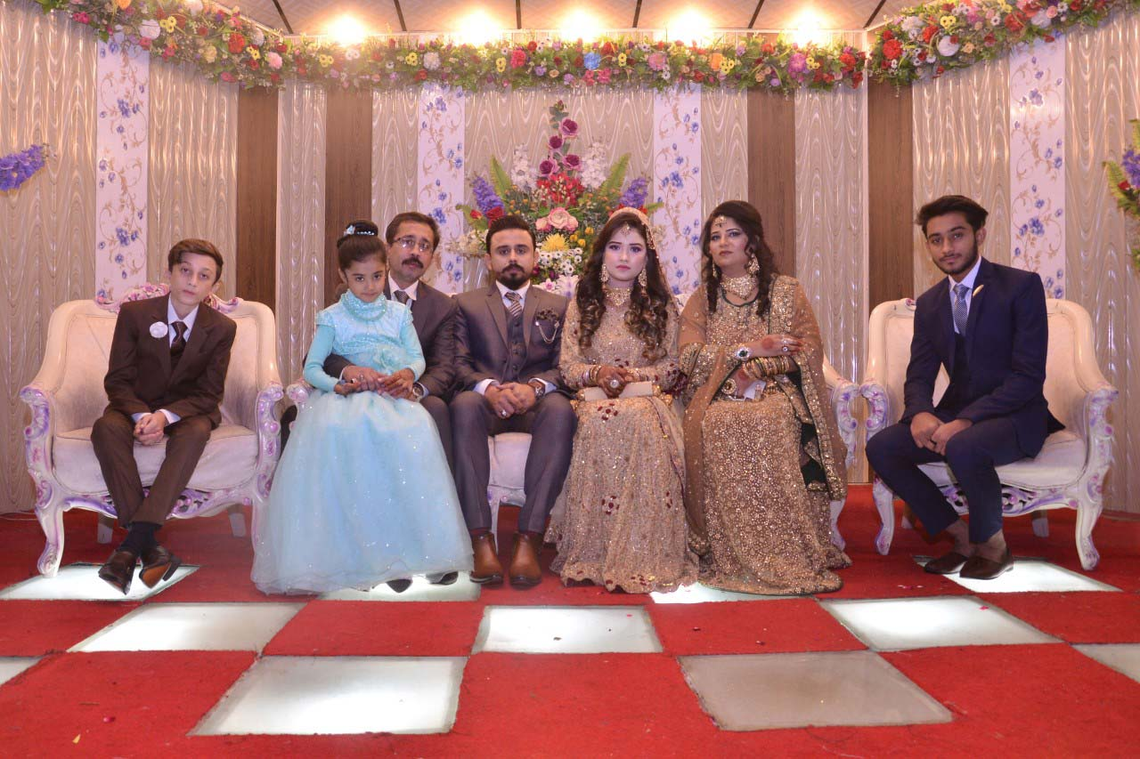 Kashif Khan and family with the newlywed couple at the Valima reception, groom elder brother