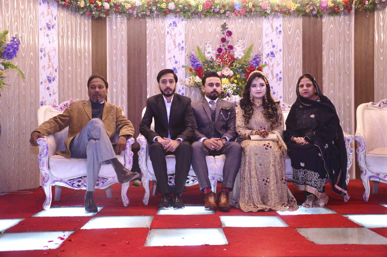 A guest family with the newlywed at the valima reception