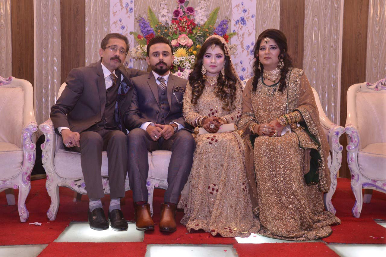 Mr. and Mrs. Kashif Ahmed Khan with the newlywed couple