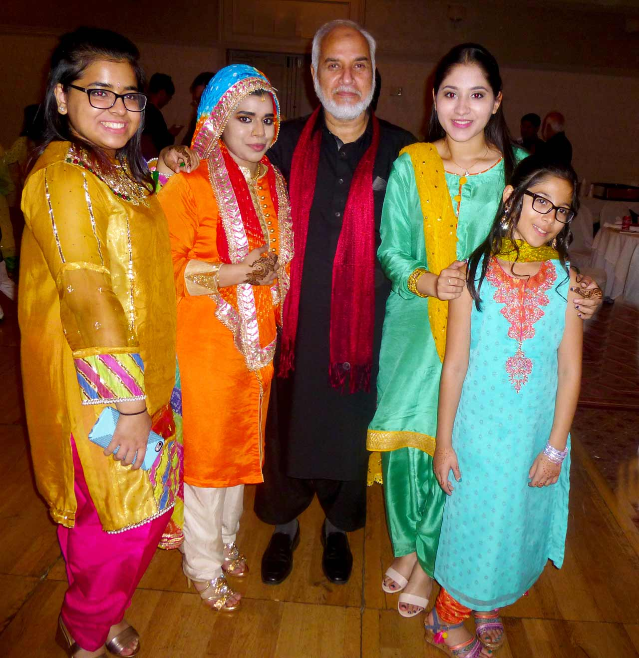 Shaikh Amin's son Tariq posing with his nieces before the Mehndi ceremony.