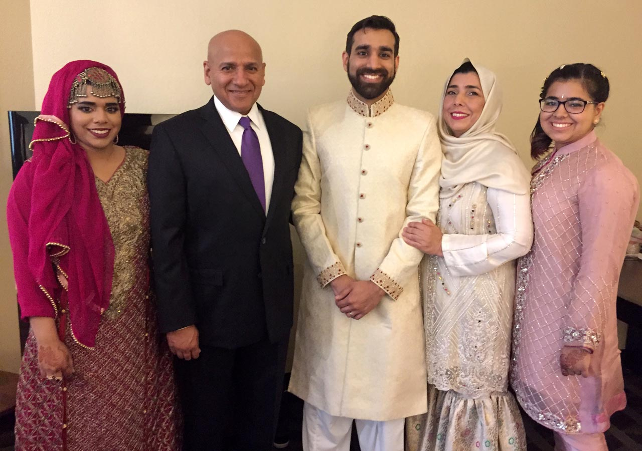 Hammad (groom) posing with his family on the wedding day.
