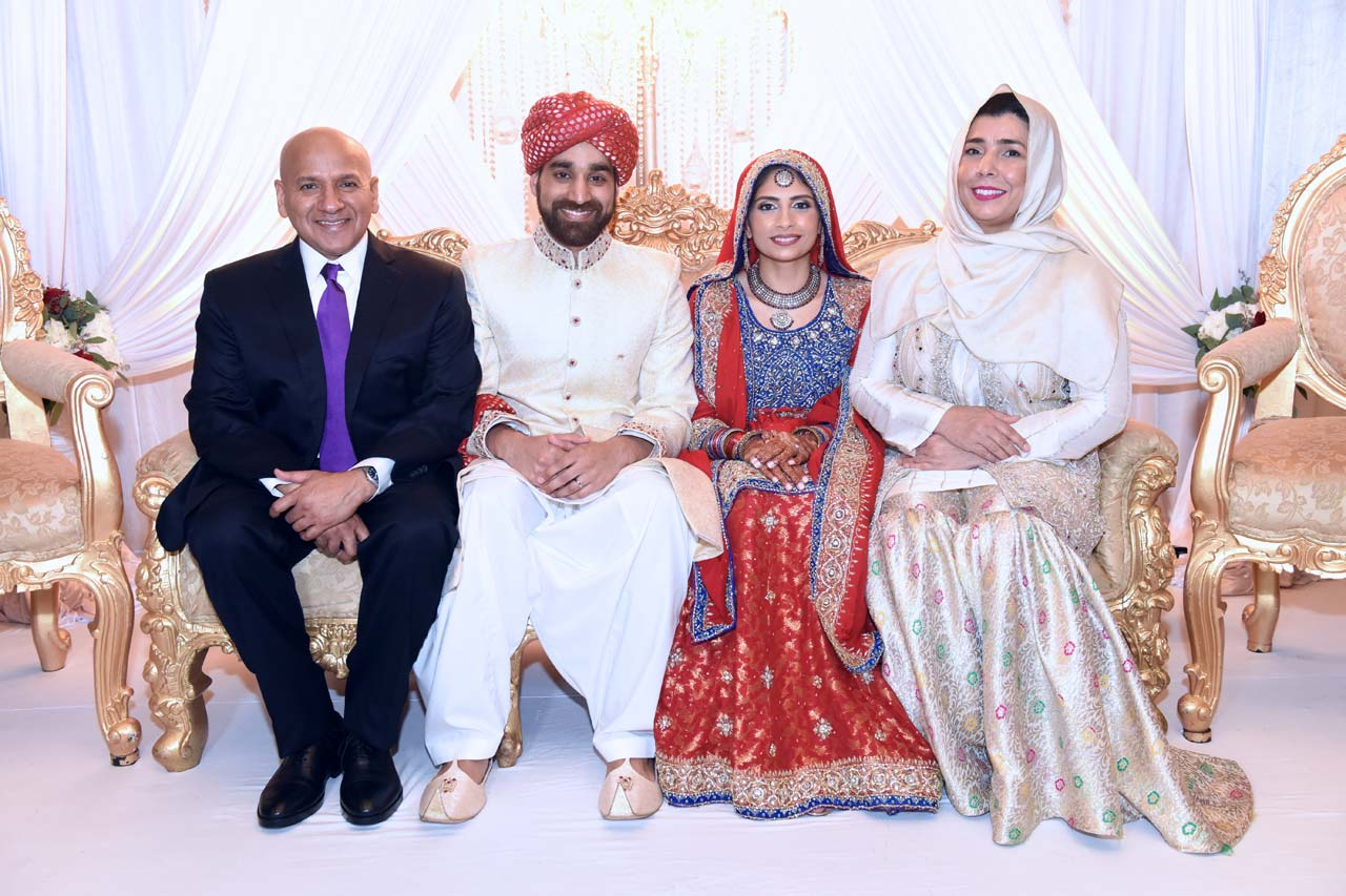 Couple posing with Hammad's parents.