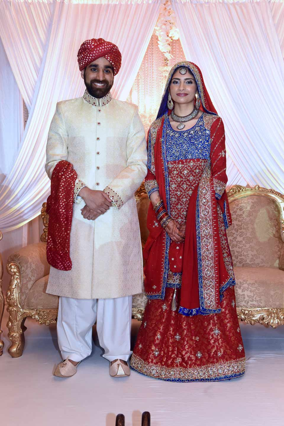 Hammad (groom) and Aneela (bride) in their traditional wedding outfit.