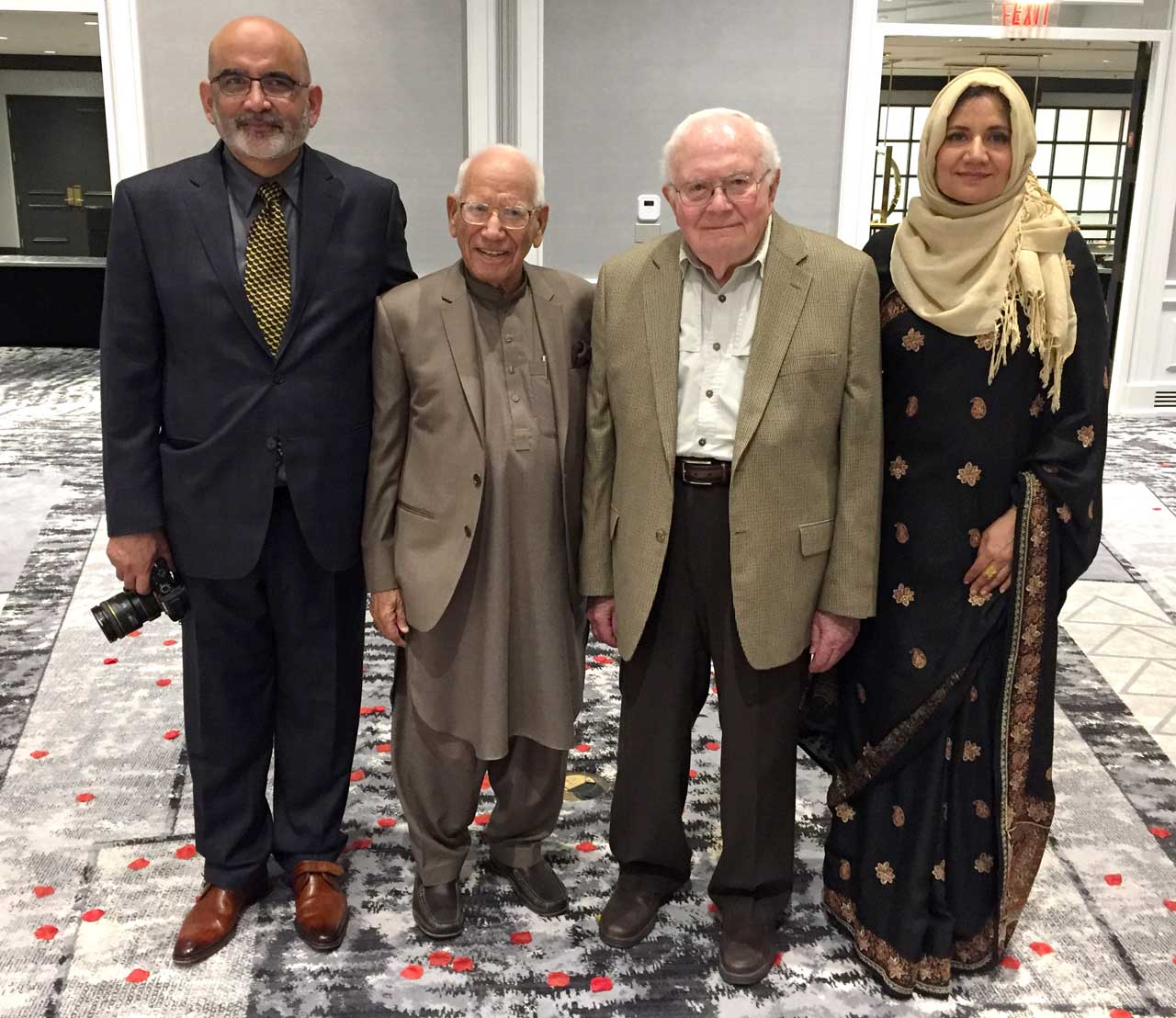 Frank and Shaikh posing with Athar and Nadia Pasha (Oregon couple and both Aramco brats).