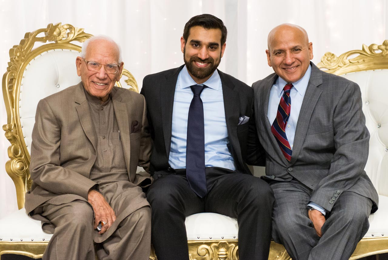 Shaikh Amin posing with his son Shahid and grandson (groom) at his walima reception.