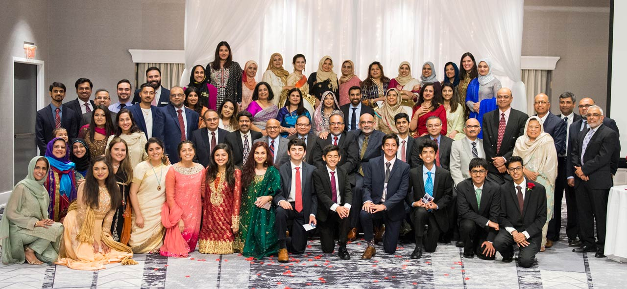 Portland-area friends and family posing with the newlyweds at walima reception.
