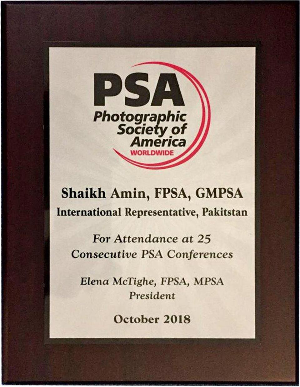 Shaikh Amin receives award for attendance at 25 consecutive Photographic Society of America conferences.