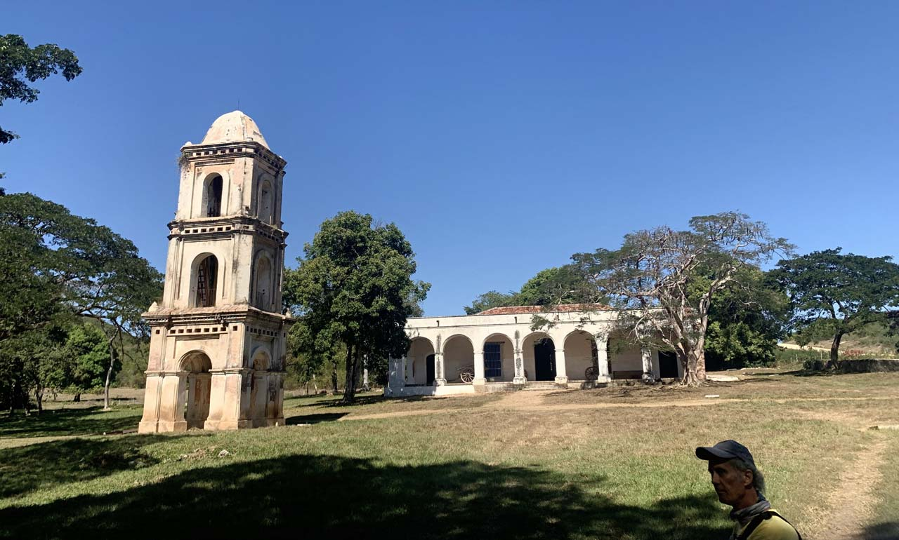 Restored sugar cane mill bell tower and owner's residence at the historic San Isidro de los Destiladeros in the Valle de los Ingenios, near Trinidad, Cuba.
