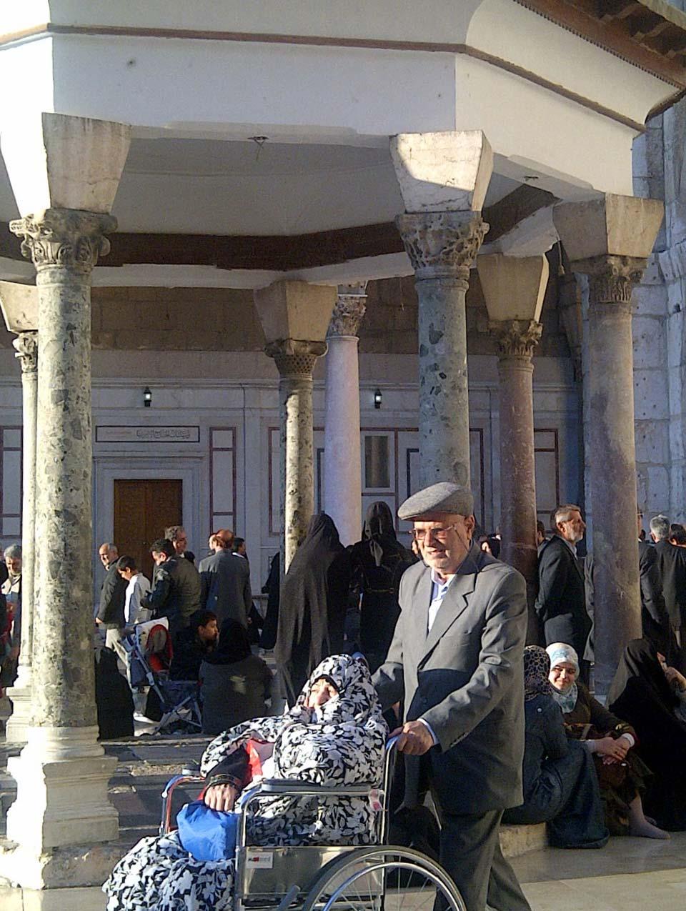 Pilgrims in the Umayyad Mosque courtyard. © Mark Lowey.