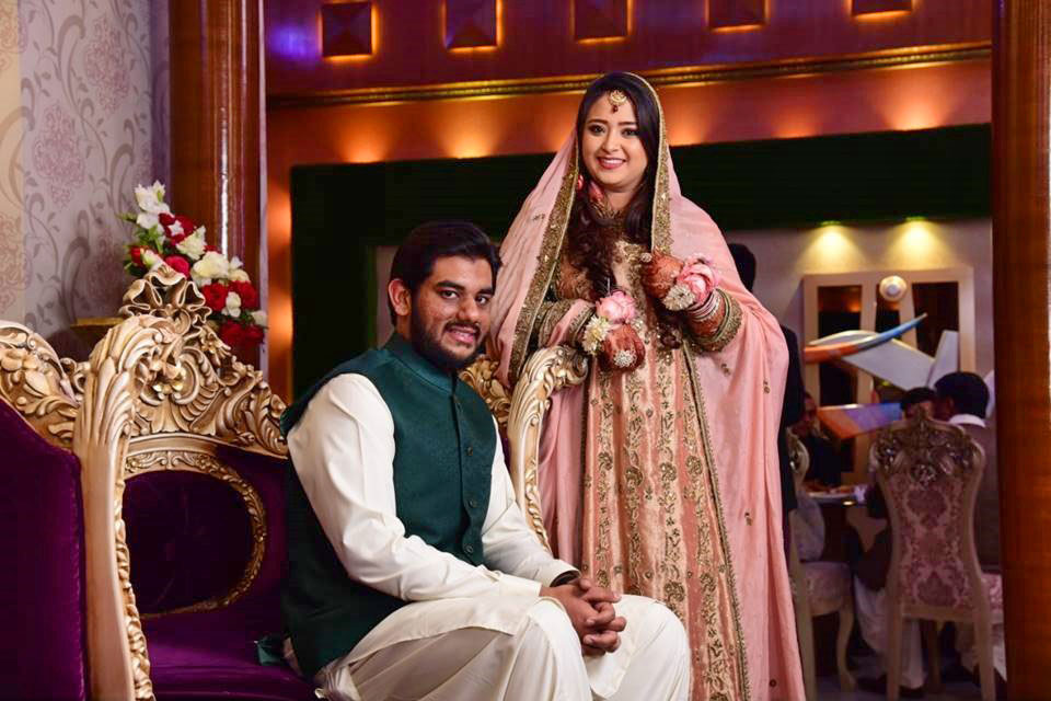 Engr. Taha Ahmed Khan with his bride Samia Siddiqui