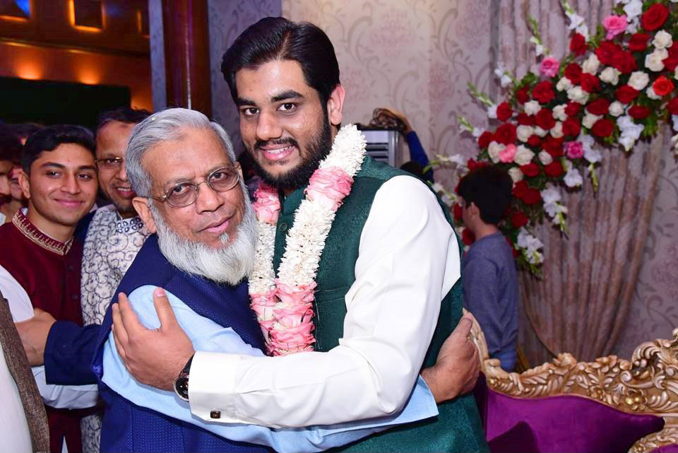 Engr. Iqbal A. Khan is greeting Engr. Taka A. Khan after the Nikah Ceremony