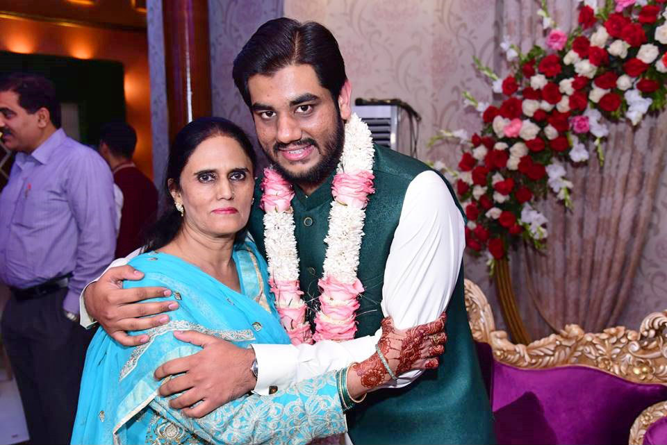 Mrs. Rudaba Irshad (Mother of Taha Khan) is greeting Taha after the Nikah Ceremony