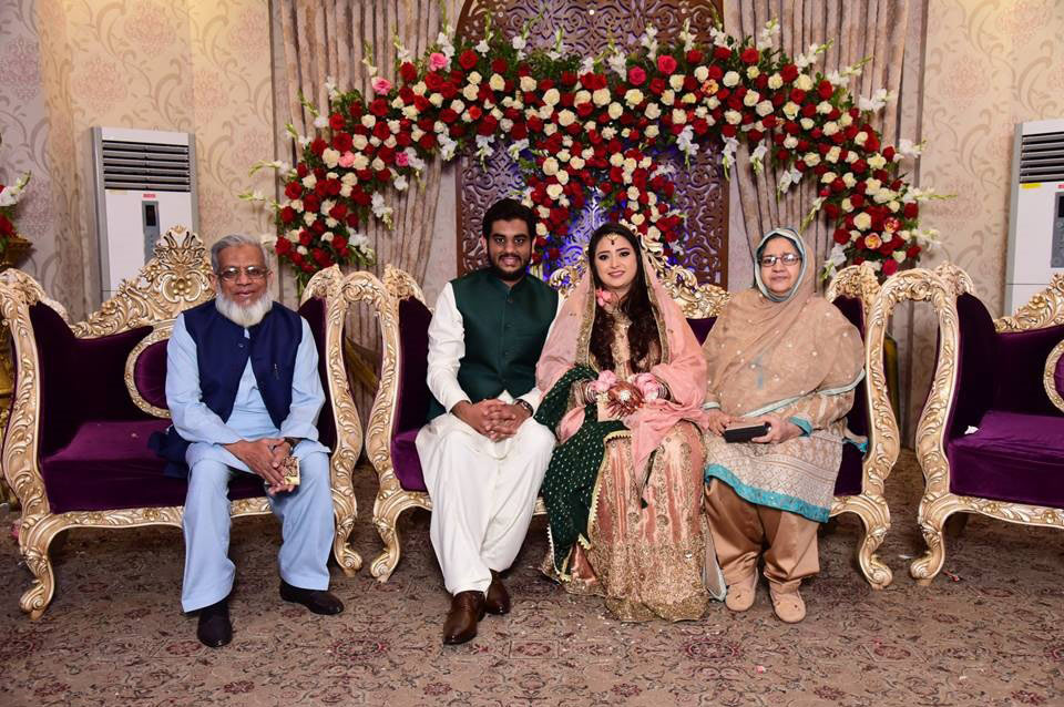 Engr. Iqbal A. Khan and Mrs. Zohra Iqbal are with the newly wed couple