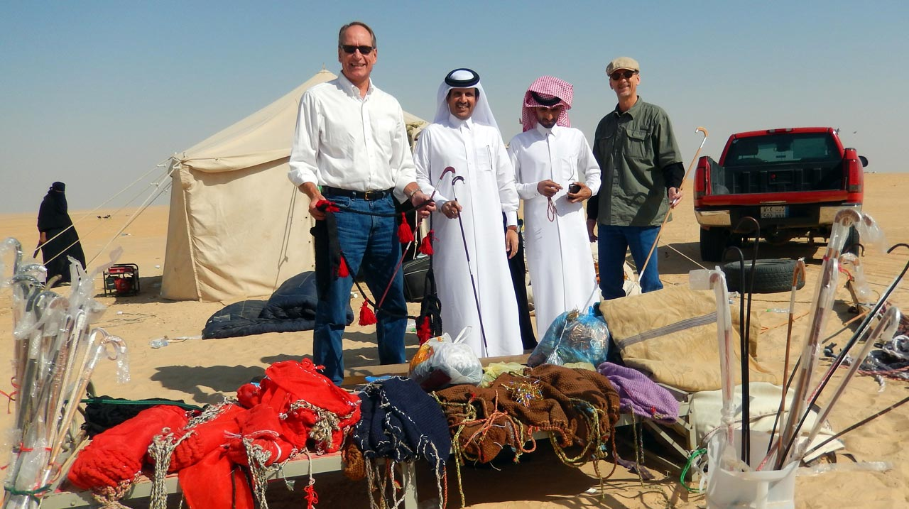 Mark, Suhaim, Nasser and Scott inspect the array of souvenirs. © Mark Lowey