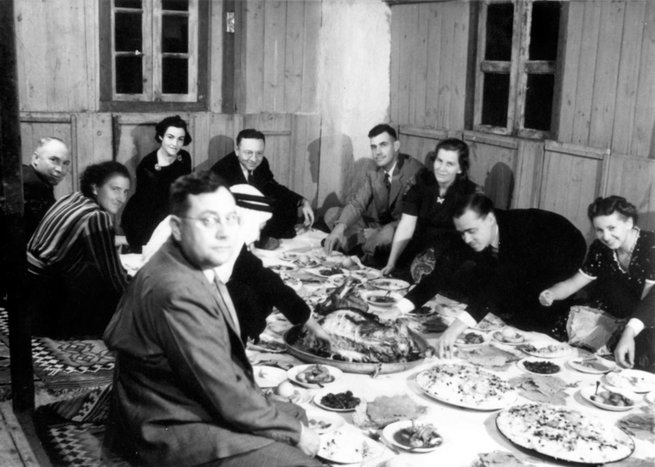 Eating a traditional Bahraini meal on the floor, 1939.