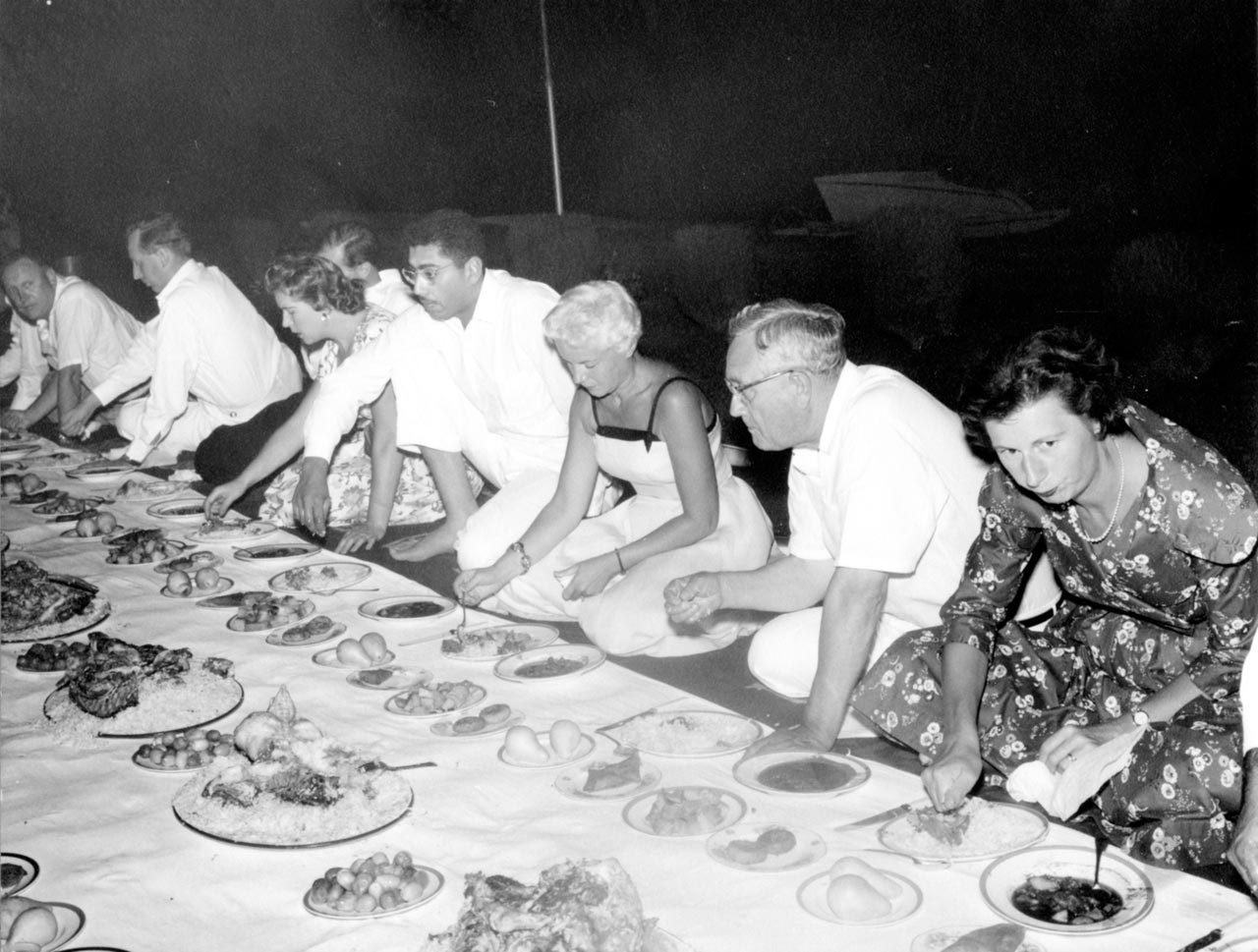 Eating a traditional Bahraini meal on the floor, 1959.