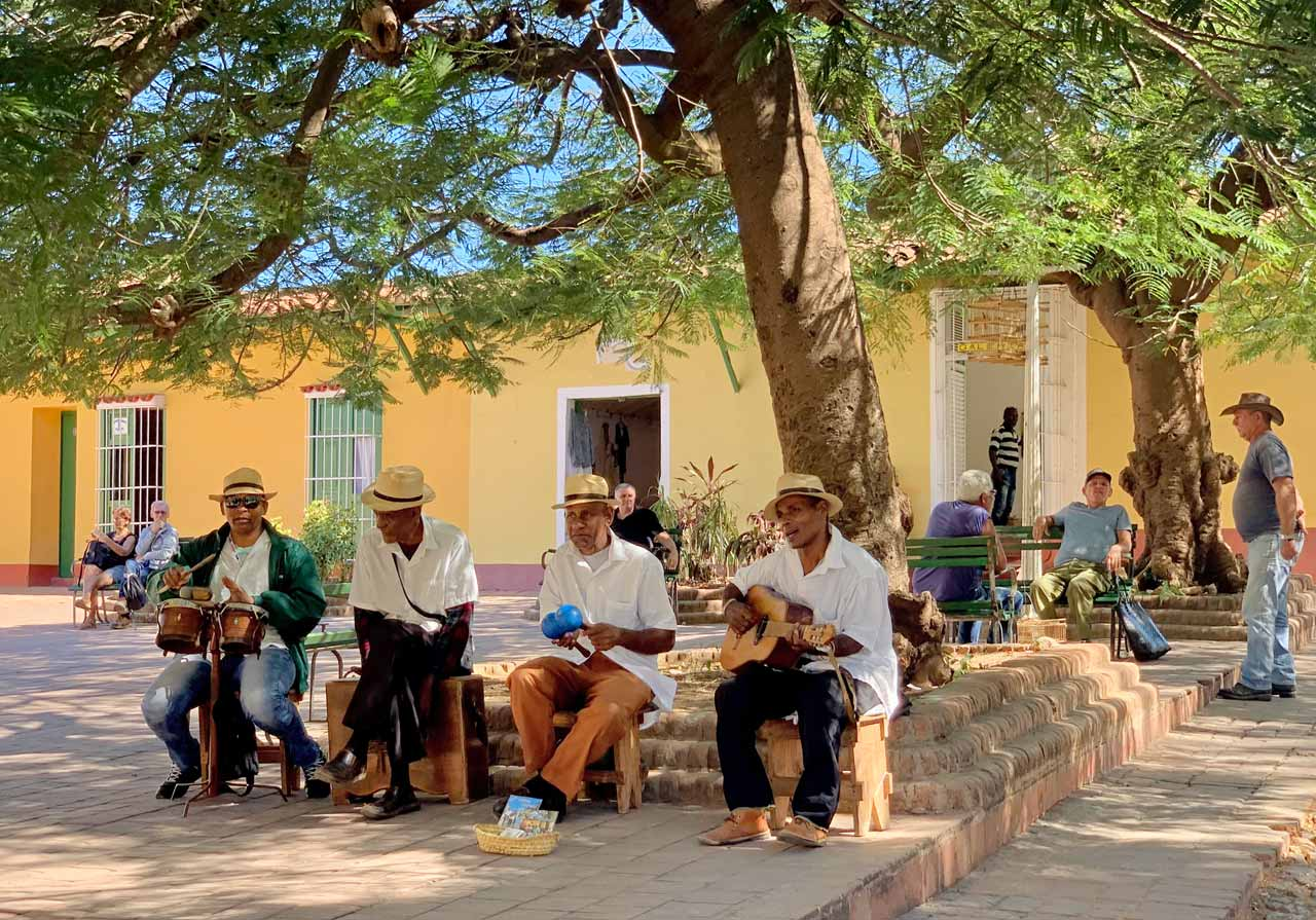 """A casual quartet strikes up the Cuban folk song """"Guantanamera"""" and passersby are invited to sing along."""