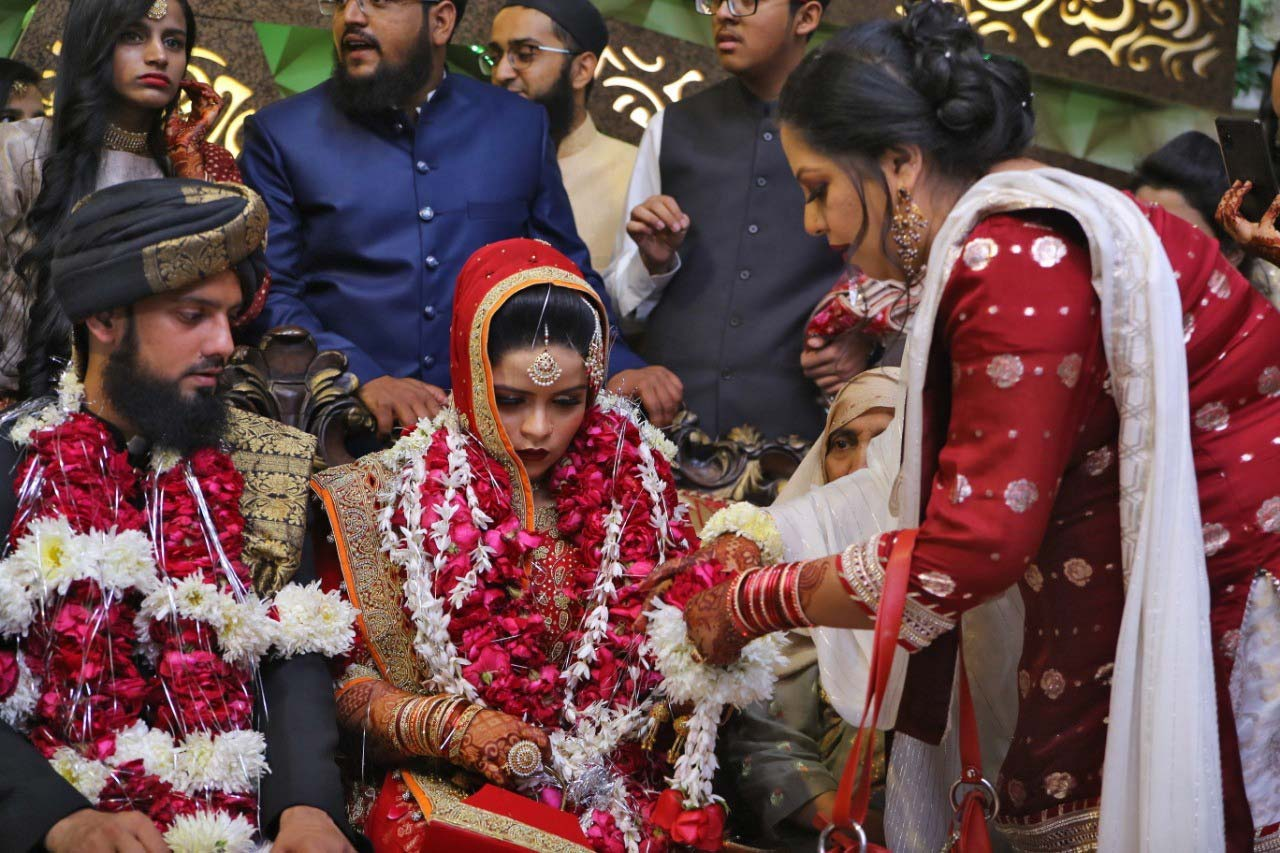 Bridegroom Muhammad Zubair Sultani, Bridesmaid Umaima Abdul Bari, Dr. Kiran Ata Ur Rehman (chahchi). In the background, Hadiya Abdul Bari, Anas Abdul Bari, Habib Ur Rehman, Grandmother of the bridesmaid.